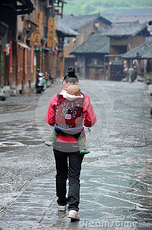 Free Chinese Miao Nationality Woman Back The Child Royalty Free Stock Photos - 25434688