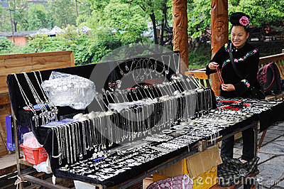 Chinese miao woman sell Silver ornaments Editorial Stock Image