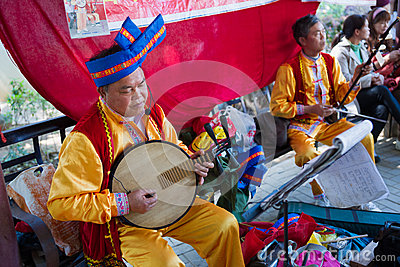 Chinese mid adult man playing musical instrument Editorial Stock Image