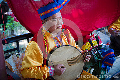 Chinese mid adult man playing musical instrument Editorial Photography