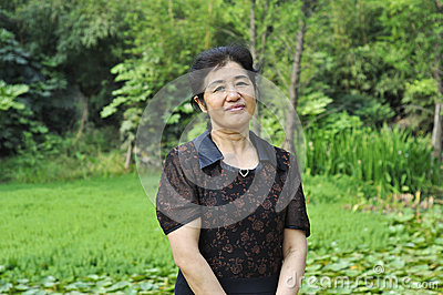 Chinese middle-aged woman in nature
