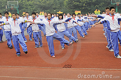 Chinese middle students do morning exercises Editorial Photo