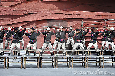 Chinese minority actors in the outdoor theater per Editorial Photo