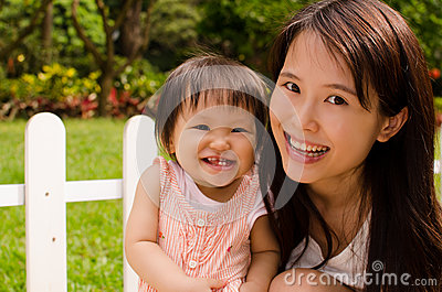 Chinese Mother and Daughter Laugh Together