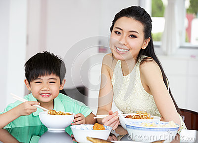 Chinese Mother And Son Sitting At Home Eating