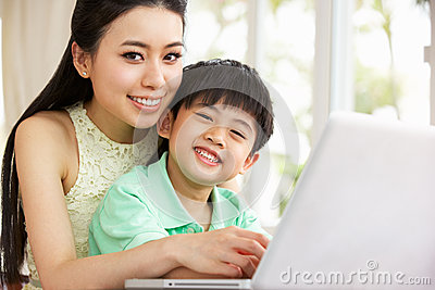 Chinese Mother And Son Using Laptop