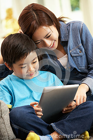 Chinese Mother And Son Using Tablet Computer