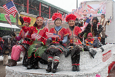 Chinese New Year Parade with Ladies Waving Flag Editorial Stock Image