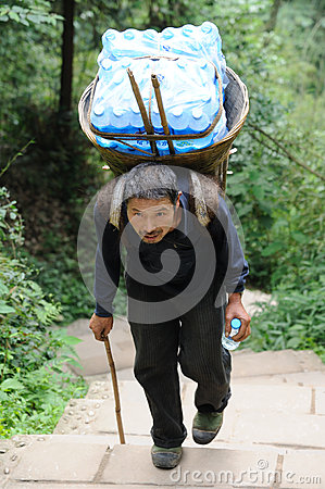 Chinese old man carry bottled water Editorial Image