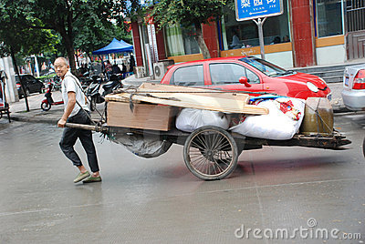 Chinese old man carry goods Editorial Photo