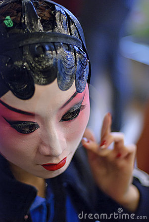 Chinese opera actress is painting face backstage Editorial Photography