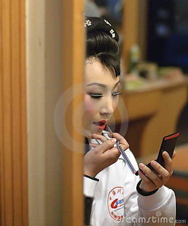 Chinese opera actress is painting her face Editorial Photography
