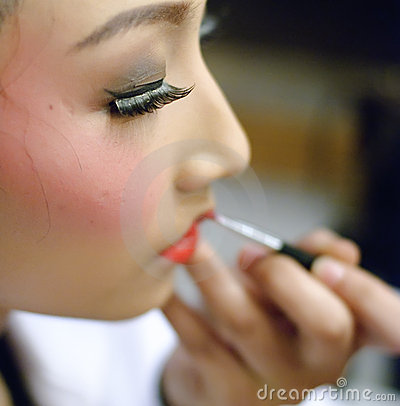 A chinese opera actress is painting her face Editorial Photography