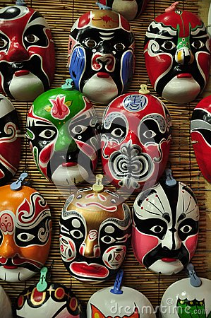 Chinese opera masks on a wall