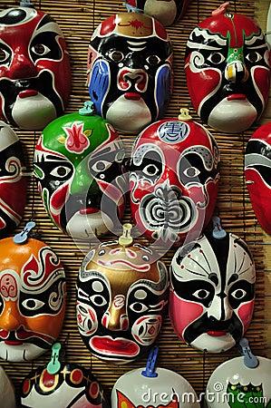 Chinese opera masks on a wall