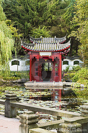 Chinese pavilion in beautiful garden with pond