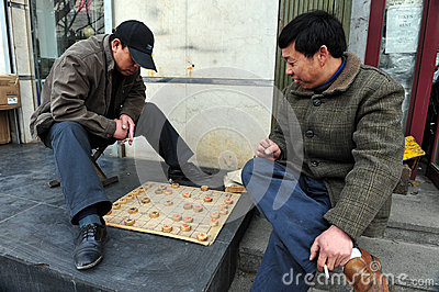 Chinese people play Xiangqi (Chinese Chess) in Beijing,China Editorial Image