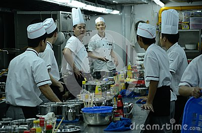 Chinese restaurant - chefs in kitchen Editorial Image