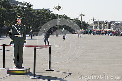 Chinese Soldider waiting for tourists Editorial Image