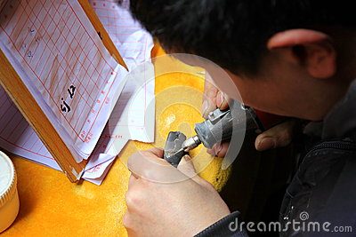 Chinese Street Engraver Editorial Stock Image