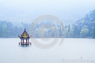 Chinese style pavilion in the middle of lake