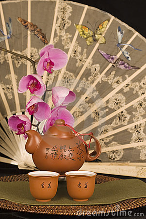 Chinese teapot and antique fan
