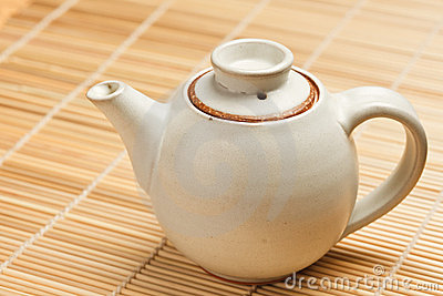 Chinese teapot on bamboo mat