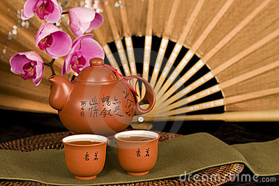 Chinese teapot and silk fan horizontal