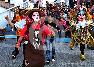 Chinese Traditional Masked Performers Editorial Stock Image