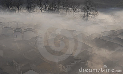 Chinese village in morning fog