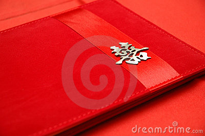 Chinese wedding guest book on red table