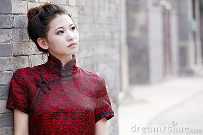 Chinese woman in the alley. Stock Photo