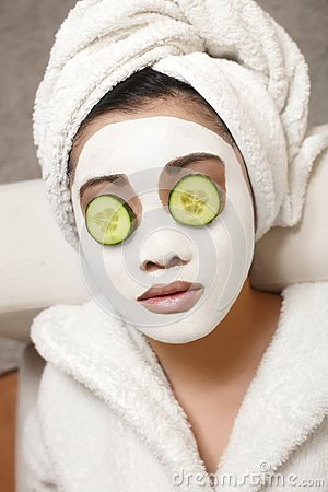 Chinese Woman with cucumbers and mask