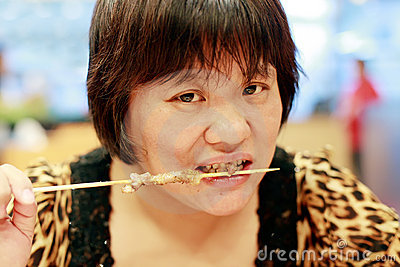 Chinese woman eating kebab