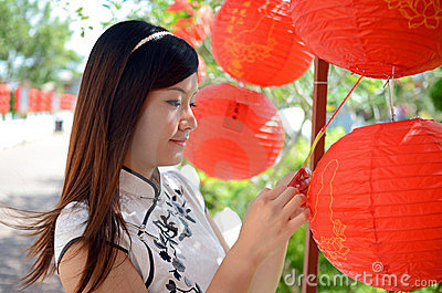 Chinese woman holding red paper lantern