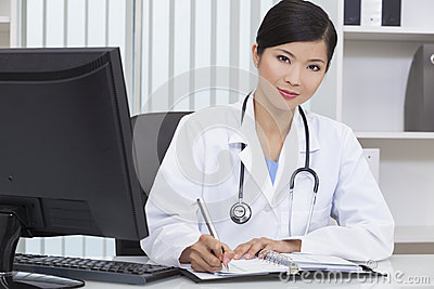 Chinese Woman Hospital Doctor Writing In Office