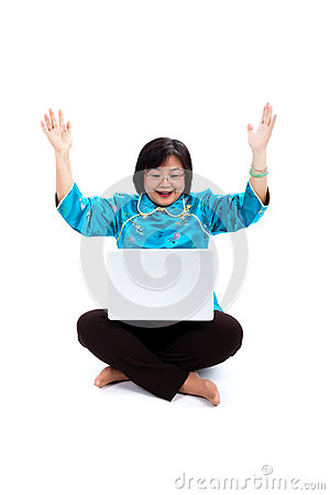 Chinese Woman with laptop, looking very excited