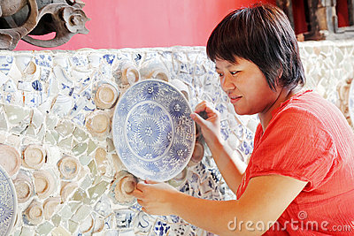 Chinese woman and old porcelain
