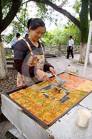 Chinese woman selling tofu on street Editorial Image