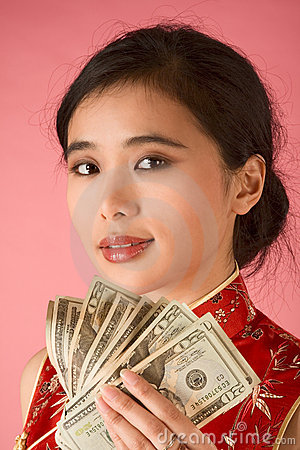 Chinese woman with US money 20 dollar bill