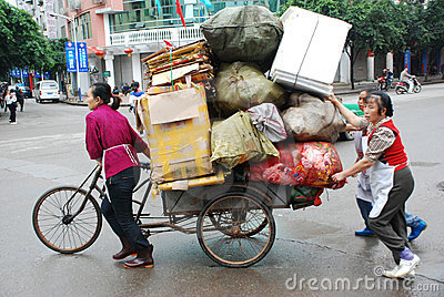 Chinese women carry goods Editorial Image
