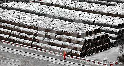 A Chinese worker walked piled rod freight yard Editorial Stock Image