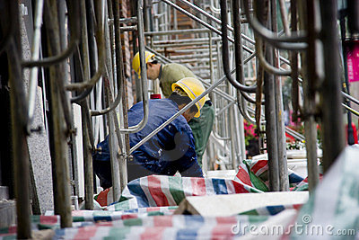 Chinese workers in scaffolding Editorial Image
