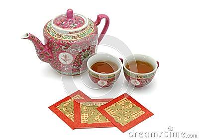 Chinesisches Langlebigkeitteeset und rote Pakete
