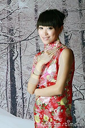 Chinesisches Mädchen in den Schneeszenen