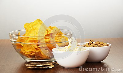 Chips, pistachios, dried squids and salty fish