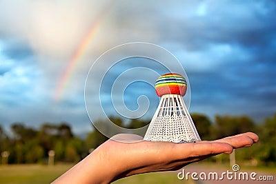Chirrido del arco iris en la mano