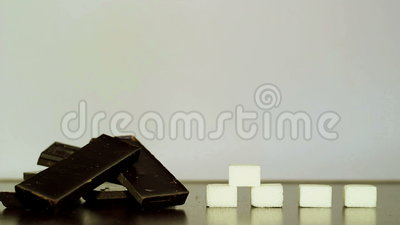 Chocolade en witte suiker stock footage