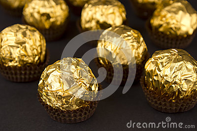 Chocolate balls on a brown background