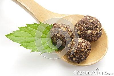 Chocolate balls on wooden spoon